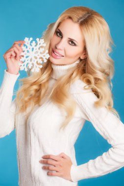 Portrait of a beautiful blonde with snowflake hands.