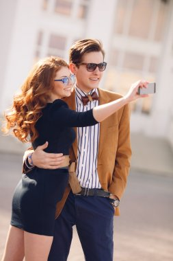 The couple is photographed with smartphone in the city