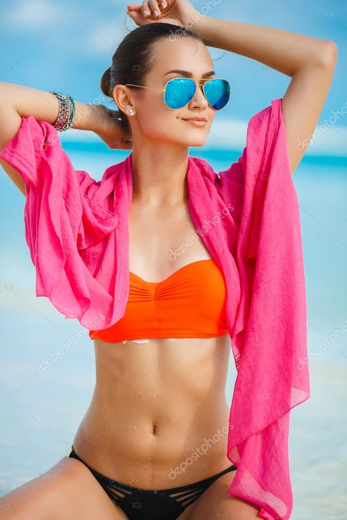 Фотообои Attractive young woman with red pareo for the beach