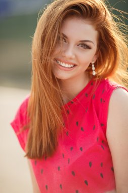 Portrait of beautiful woman with red hair