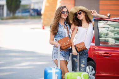 Summer vacation to beautiful women travelling by car