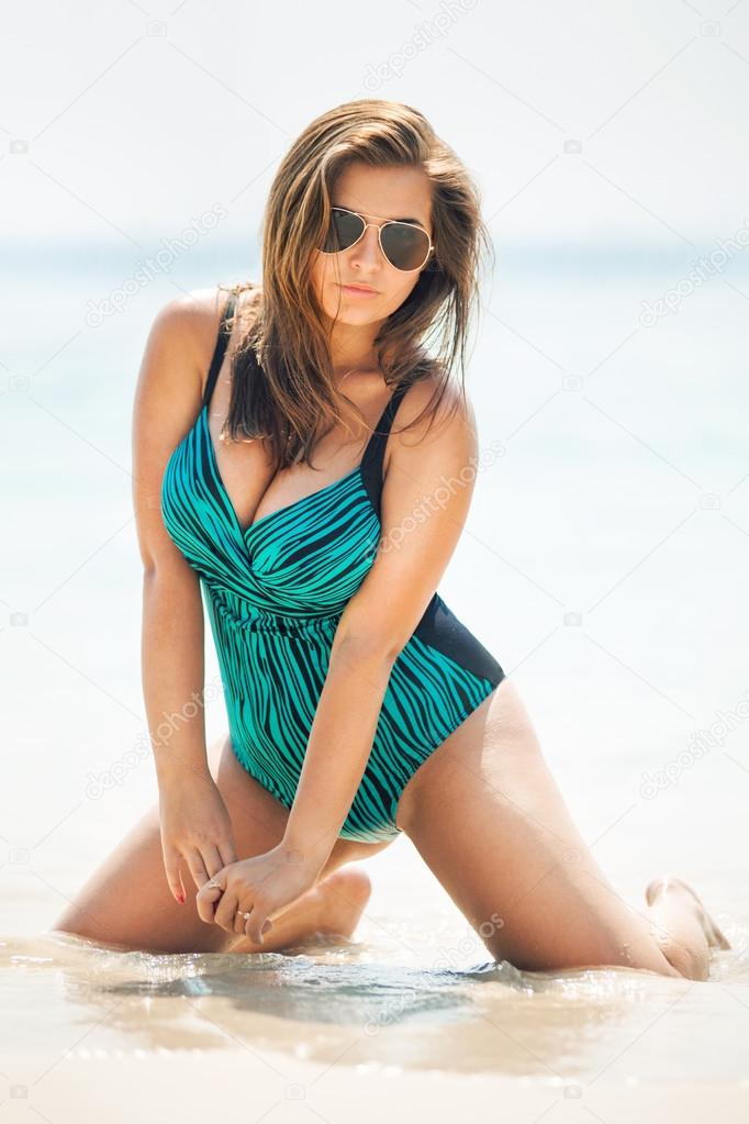 Fat hot and sexy woman in swimsuit near the sea