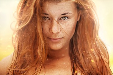 Summer portrait, beautiful freckled young woman with red hair