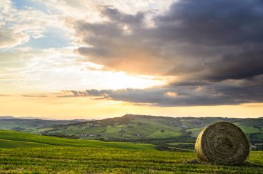 Haystack at sunset, Tuscany landscape, Toscana, Italy stock vector
