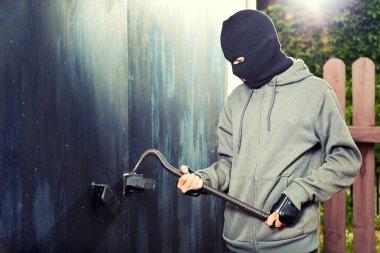 Night burglary garage door