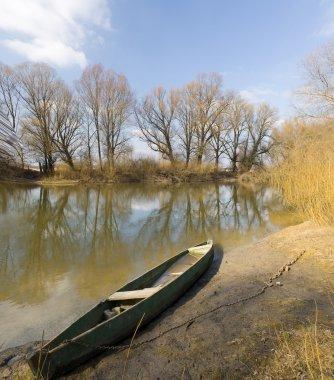 wooden boat on spring river.