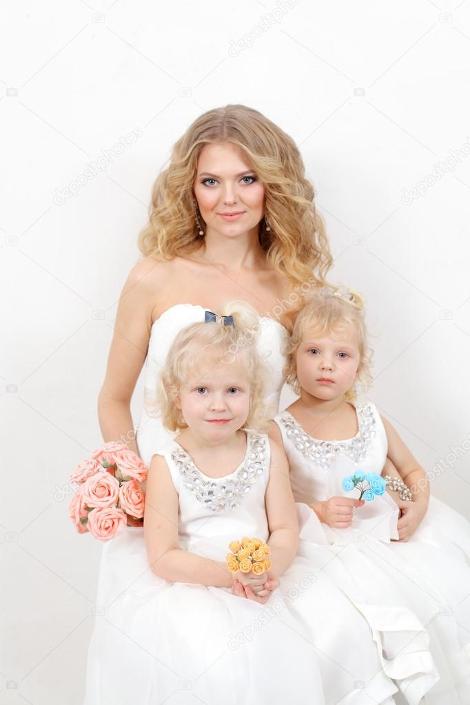 Beautiful mother and daughters in studio