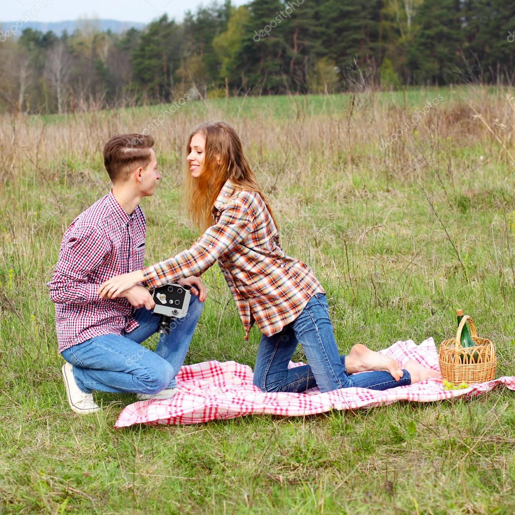 Hipster couple having picnic on nature