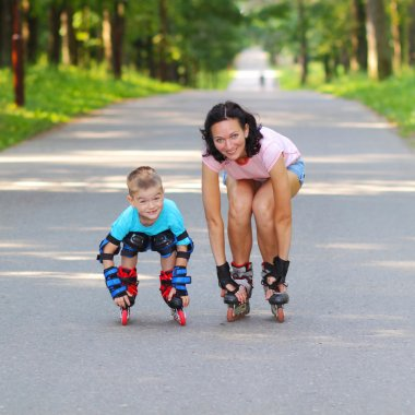 Mother and son learn roller skating