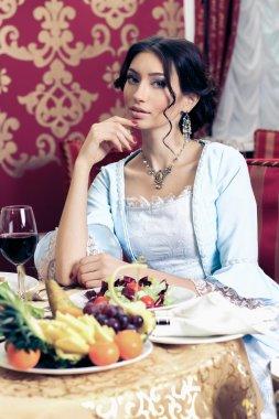 Beautiful retro woman in restaurant