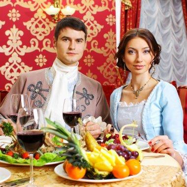 Retro couple dining in restaurant