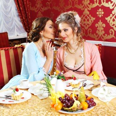 Retro dressed girls in restaurant