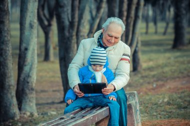 Grandfather and grandson with tablet