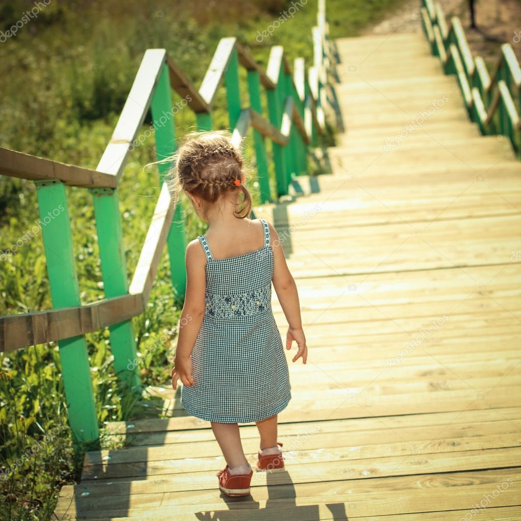 Girl Walking Down The Stairs Stock Image - Image of happy