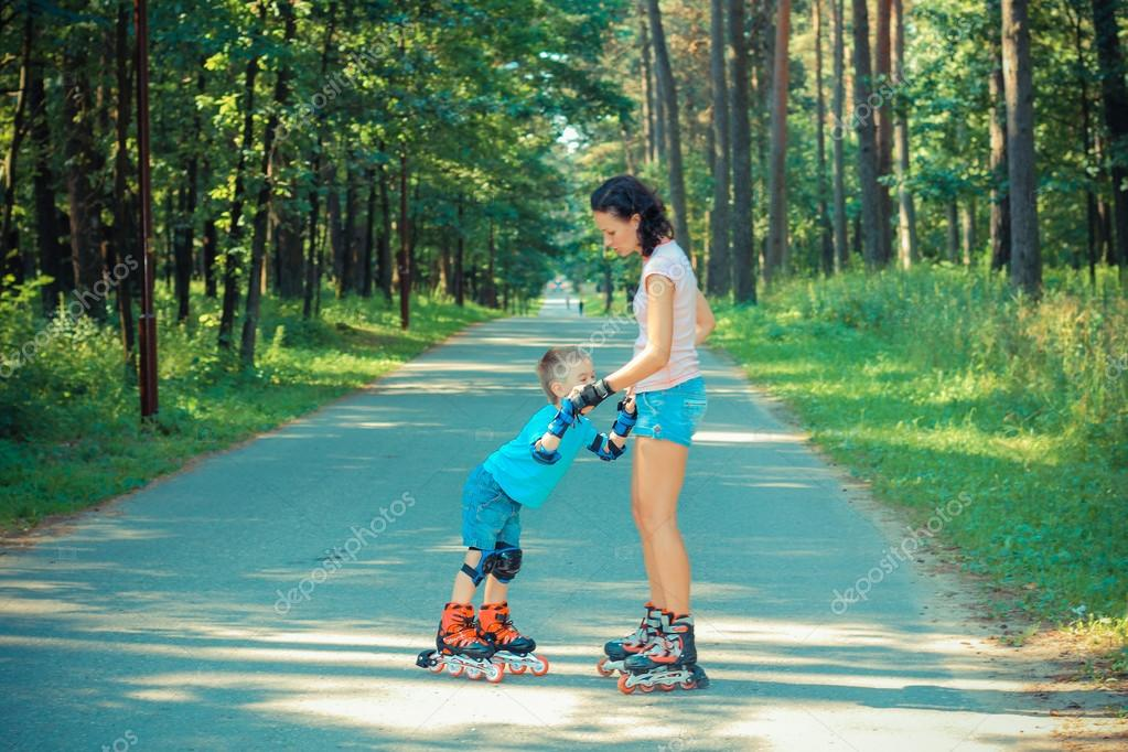 Mother and son learn to roller skate