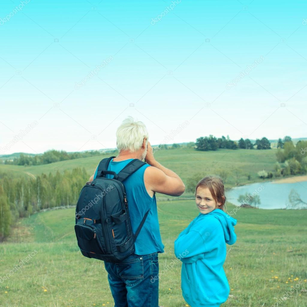 Man on a camping trip with his granddaughter