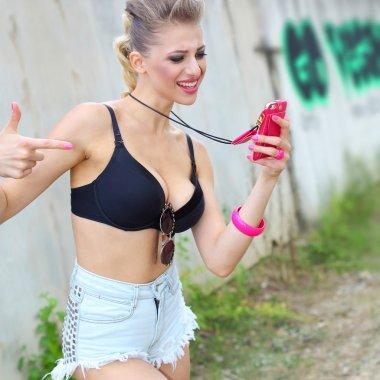 hipster girl emotionally speaks on the phone