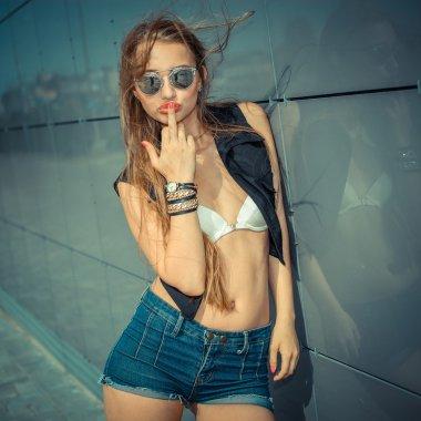 hipster girl showing obscene gesture