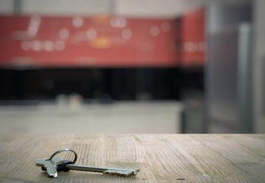Metal keys laying on table