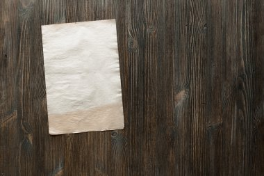 paper on old wooden surface