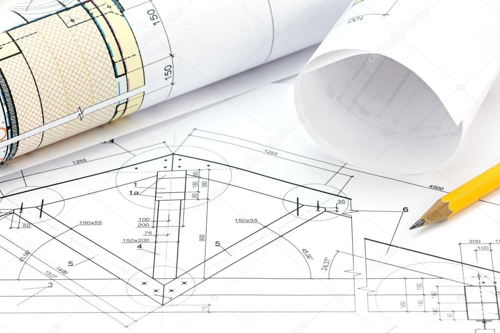 architect workspace with blueprint rolls and pencil stock photo