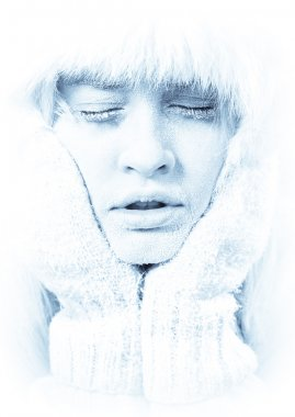 Frozen. Chilled female face covered in ice.
