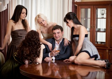 Four pretty women seduce one man in a room