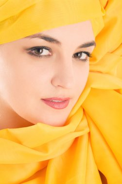 Woman covering with yellow cloth