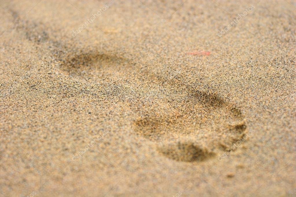 Footprint on sand background