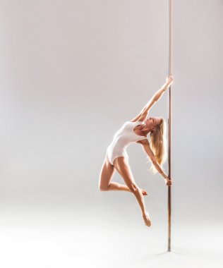 Beautiful blonde sexy pole dance woman
