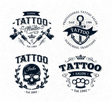 Vector tattoo studio logo templates on white background. Cool retro styled vector emblems. stock vector