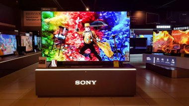 LATVIA, RIGA, JULY, 2021 - Showroom of modern electronics with new generation large TV-sets  in the shopping mall in Riga, Latvia