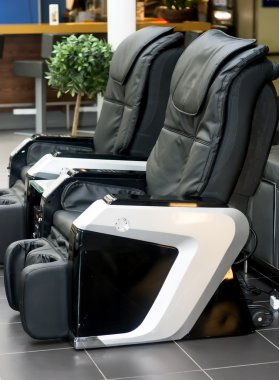 Two electric leather comfortable massage chairs