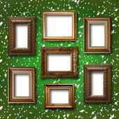 Fotografie Gilded wooden frames for pictures on abstract blue background