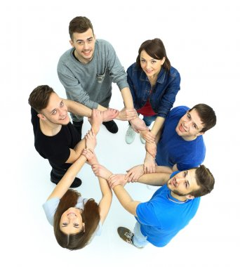 Top view of young people with their hands together in a circle. stock vector