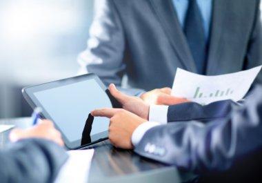 Business man holding digital tablet stock vector