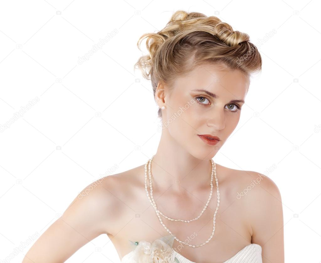 Young beautiful blond woman with a wedding hairstyle — Stock Photo ...
