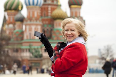 Mature blonde woman on Red Square in Moscow