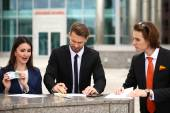 Business people sign a contract