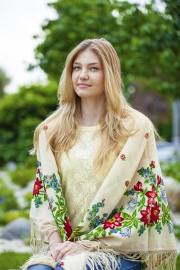 Russian woman in the national patterned scarf