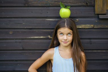 Picture of beautiful girl with green apple