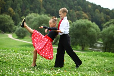 Little girl in a beautiful dress dancing