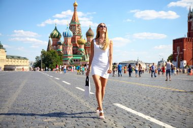 Young women walking in white dress at the red square in Moscow