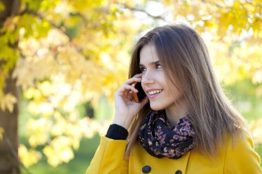 Happy beautiful woman calling by phone