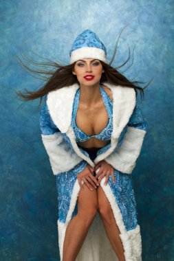 Young beautiful woman dressed as Russian Snow Maiden