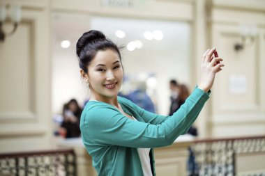 Young beautiful asian woman tourist taking pictures