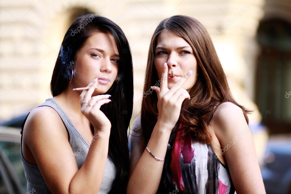 https://st2.depositphotos.com/1000824/7048/i/950/depositphotos_70488995-stock-photo-two-women-smoking-cigarettes-on.jpg