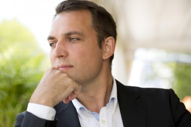 Portrait of a young business man in a dark suit and white shirt