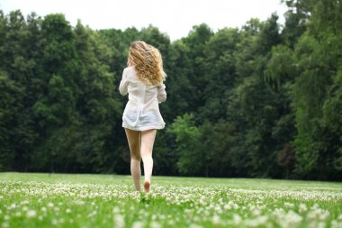 Young beautiful blonde woman walking away