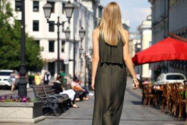 Beautiful young blonde woman in long dress